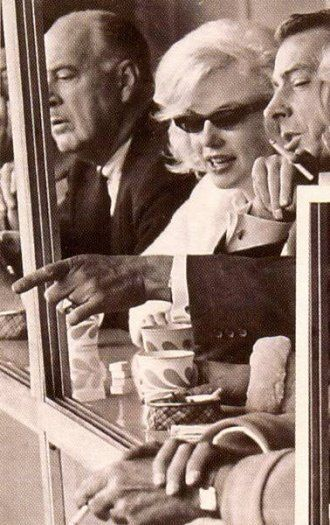 Marilyn with Joe DiMaggio at a Yankee game, April 11, 1961.