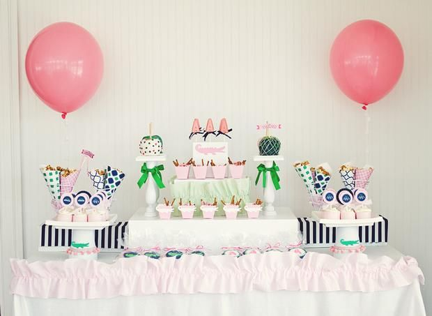 Hostess with the Mostess® - Preppy Alligator - pink cups filled with pretzel sticks, yogurt pretzels and marshmallows - cake stand bottom covered to look like party hat with alligator and pom pom trim