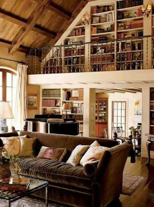 Like the bookshelves on the loft cozy home libraries for Decorating with books house beautiful
