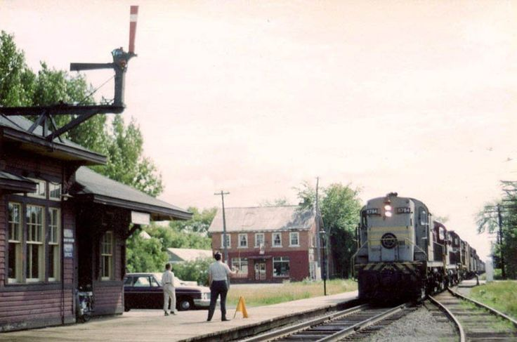 This shot is taken at beautiful downtown Stittville, mileage 13 on the Carleton Place Subdivision. Bill Linley took this shot of me hooping up orders to regular freight train #90 engine 8784 which ran from Smiths Falls through Carleton Place to Ottawa West. This was on Dominion Day 1965, my first year of employment as an operator. Bill Linley/Bruce Chapman Collection