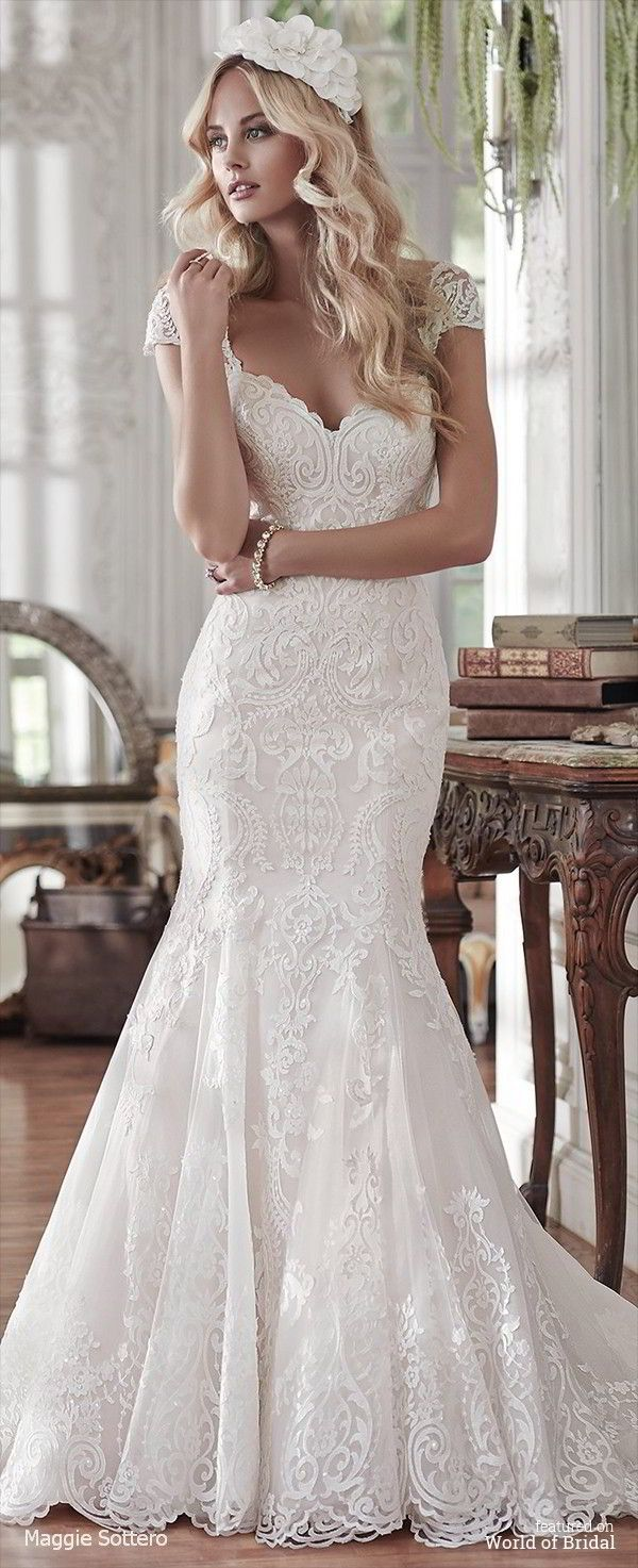 Lovely in lace, this fit and flare wedding dress is the epitome of beauty with bold lace appliqués laying atop tulle, cascading to a subtly flared skirt. Finished with sweetheart neckline and corset closure. Detachable lace cap-sleeves sold separately.