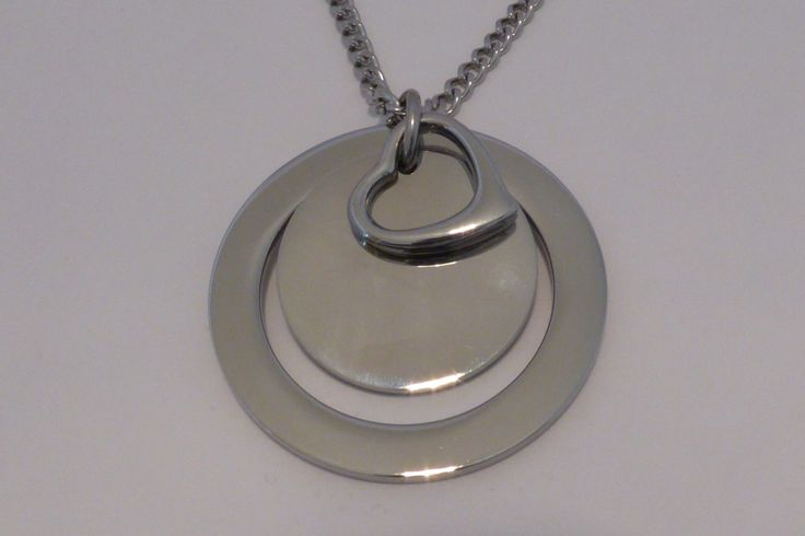 This is the 'Melissa' necklace. 38mm outer diameter and 2mm thick. Available in Stainless Steel Gold $65 and Stainless Steel Silver $55. You can choose your own words to have stamped on it or leave it blank.