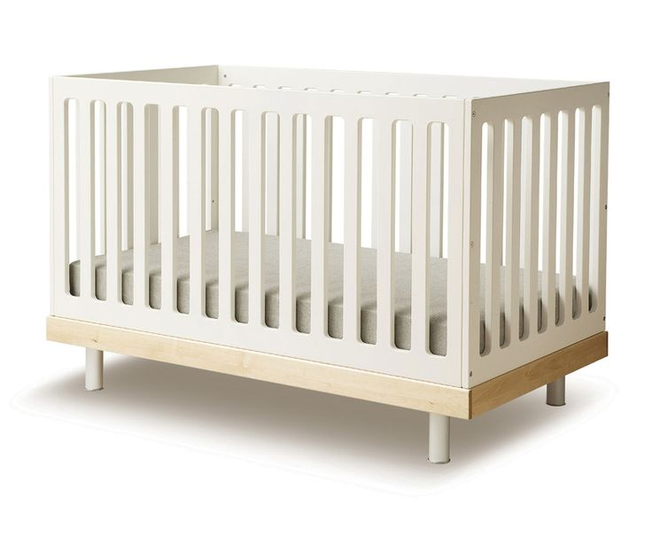 Created by parents who understand the importance of both safety and style, this clean, contemporary crib by Oeuf is made of sturdy solid wood. With a conversion kit, it grows with your child, converting from crib to toddler bed with ease. #Oeuf #CribCache