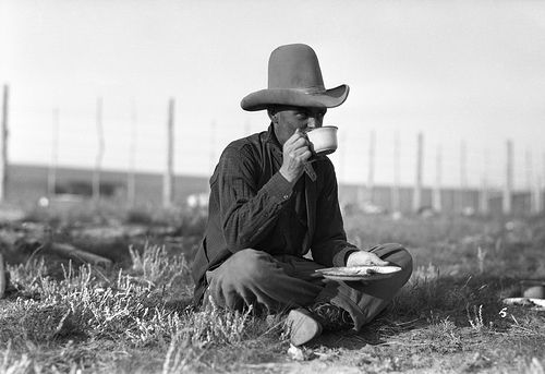 Cowboy having meal during cattle round-up drive. Photograph: W.J. Oliver, 1926 [Glenbow Museum]