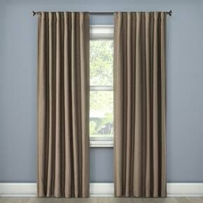 Block out the sun to enjoy movies during the day with the Linen Look Lightblocking Curtain Panel from Threshold. This blackout curtain will keep your room dark in the daytime and has a pocket to accommodate your curtain rod.
