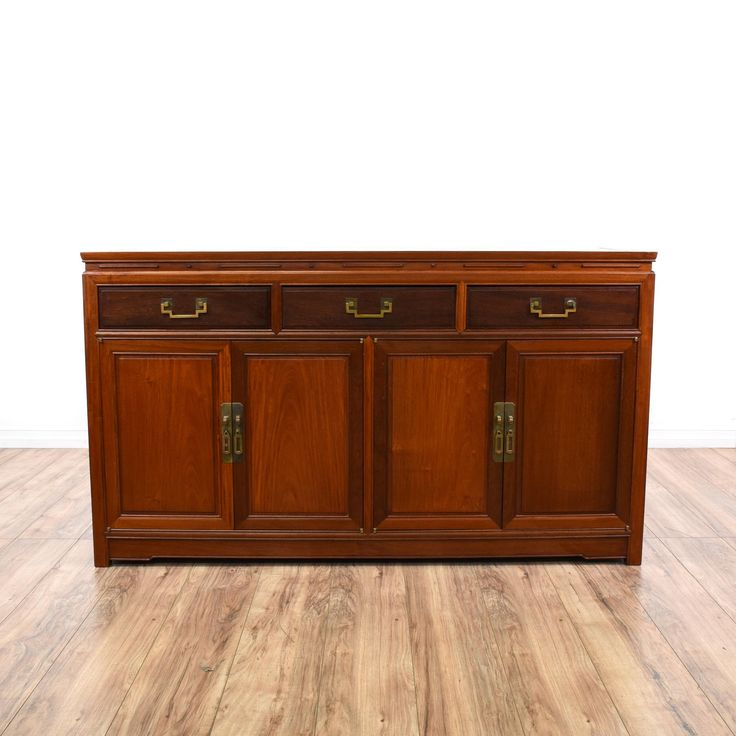 "This ""George Zee & Co."" sideboard buffet is featured in a solid wood with a gorgeous rosewood finish. This asian credenza has 3 drawers, large interior cabinets and carved clean lines. Stunning bar perfect for dishes and drinks! #asian #storage #buffet #sandiegovintage #vintagefurniture"