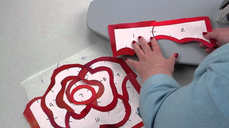 Discover how to machine appliqué in a whole new way! Rose Hughes' Fast-Piece Appliqué technique demonstrates how to use freezer paper for applique quilts tha...