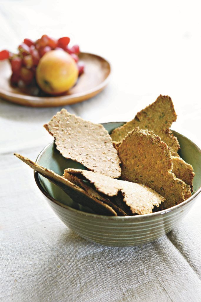 Linseeds, also called flaxseed, are a rich source of omega-3 oils, as well as providing protein, fibre and iron. These crisp, salt-scattered crackers are an irresistible way to eat them. They look wonderful too, with their slightly curled-up form, and random, rough-edged shape. Serve them with dips or soups, or just leave a dish in the kitchen for opportunistic munching.