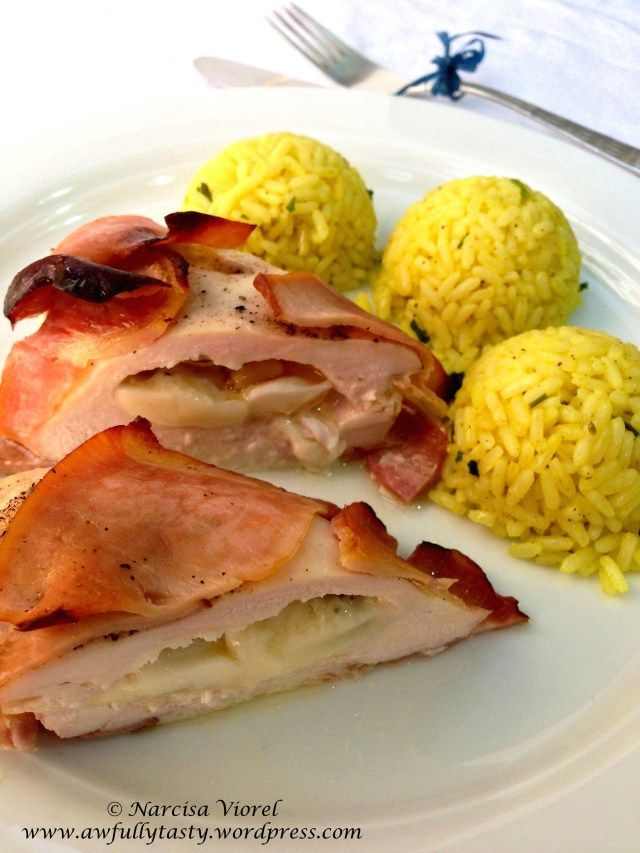 Stuffed chicken breast with blue cheese, mozzarella, feta, brie and pine nuts, wrapped in bacon and served with curcuma rice. Amazing dish!
