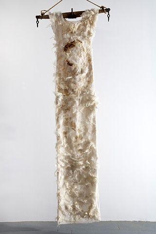 "Moira Bateman  Nightdress 4; Mnemosyne Series  2012  Linen textile, onion skin dye, raw wool, ox yoke, rope  114""x30""x3""."