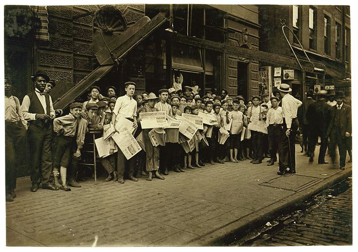Waiting For The Signal. Newsboys, starting out with base-ball extra. 5 P.M., Times Star Office. Location: Cincinnati, Ohio. Photograph by Lewis Wickes Hine, August 1908.