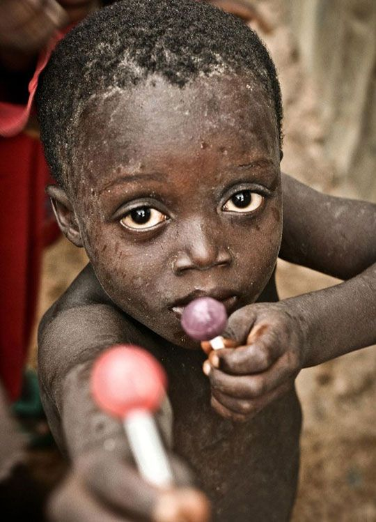 Child Offers To Share A Lollipop With The Photographer, Amazing Photo By Emil Leonardi