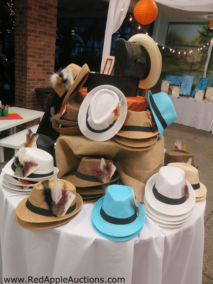 A Havana-themed school auction had these awesome fedoras for guests -- an instant costume!  #SchoolAuctionThemes