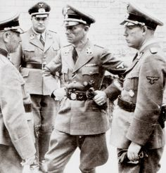 "Pin by Paolo Marzioli - SS-Gruppenführer and Police General Hans Weinreich (center) talks with staff officers of the Technische Nothilfe (Technical Emergency Assistance) a civil defense organization. Known by the abbreviation ""TENO,"" this organization was responsible for repairing and maintaining public works and large facilities. Weinreich was TENO chief from 1937 until 1943, when he was dismissed by Himmler because he married a prostitute.He survived the war and died in 1963."