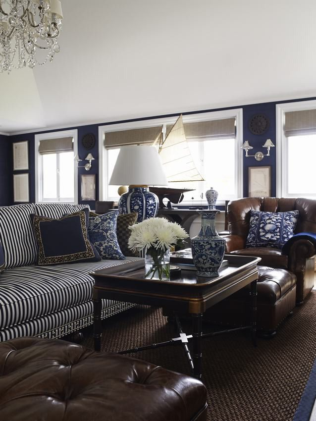HOME DECOR – COASTAL STYLE – east brisbane guest house; pursuing a new england-style aesthetic, this one-bedroom guesthouse is warm, layered and intentionally full to the point of appearing pleasingly 'cluttered'; a palette of navy, walnut and white was chosen as the backdrop to key pieces from ralph lauren, bringing a country estate feel in keeping with the striped sofa and brown leather chairs.