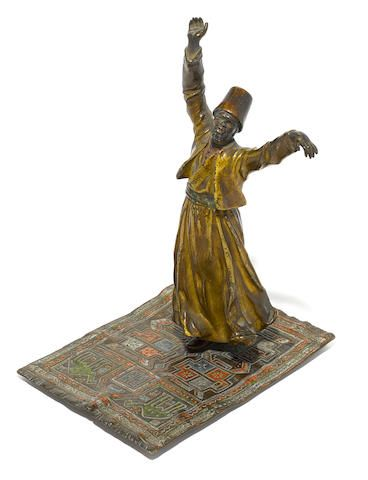 A Franz Bergman cold painted bronze figure of a whirling dervish on a rug early 20th century