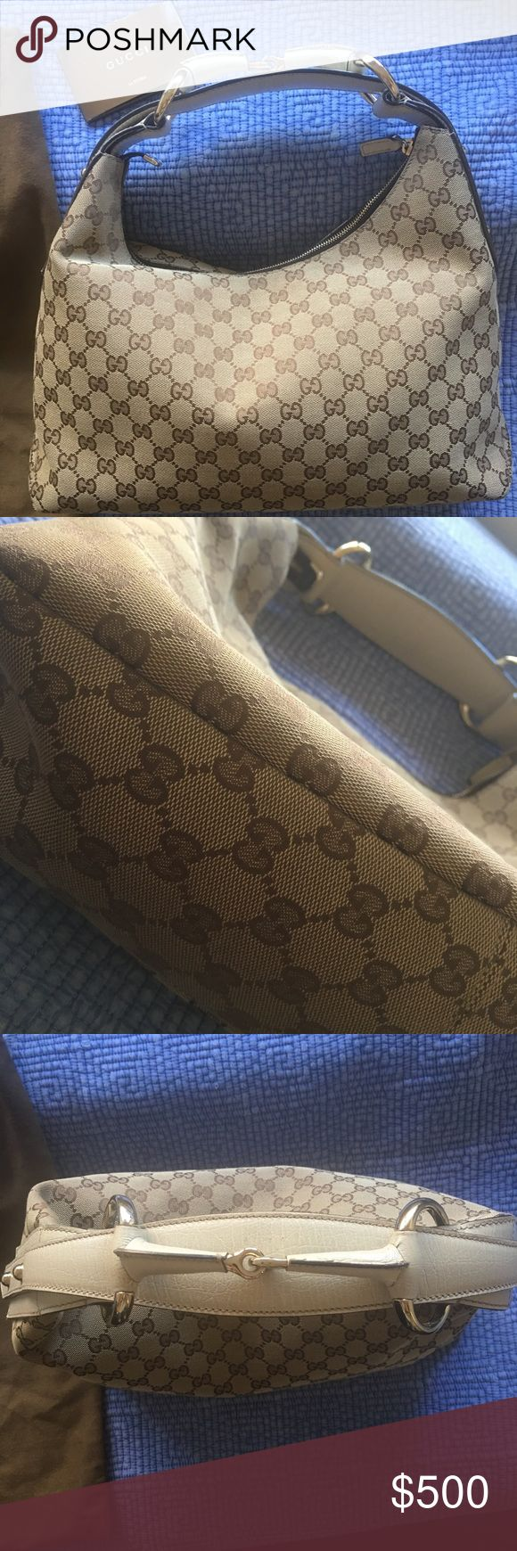 2008 Women's Gucci bag MINT condition This is authentic with official paperwork and receipt to prove it. The receipt faded a bit since it was bought in 2008 so I tried to filter it as much as possible so you can see the price my mom paid for it and the location where it was bought. It's in near mint condition. The only thing I don't have is the box but I have the Gucci cover for the bag. Price is negotiable let me know your best offer! Gucci Bags Shoulder Bags