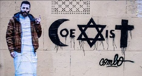 French street artist Combo was severely beaten over his latest street art which calls for peace between Muslims, Jews and Christians.