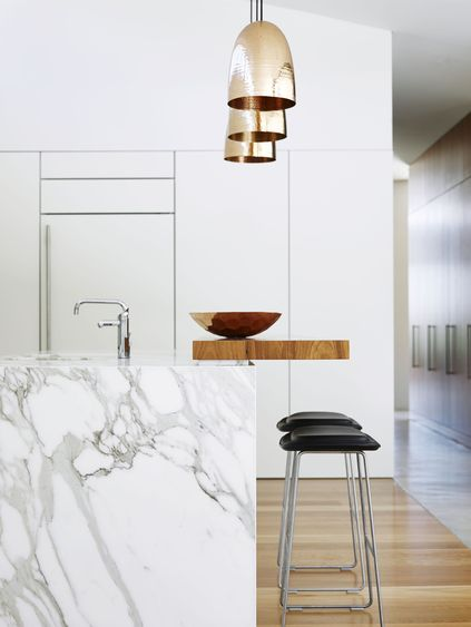 Gorgeous kitchen design - marble island and brass pendants. Arent & Pyke