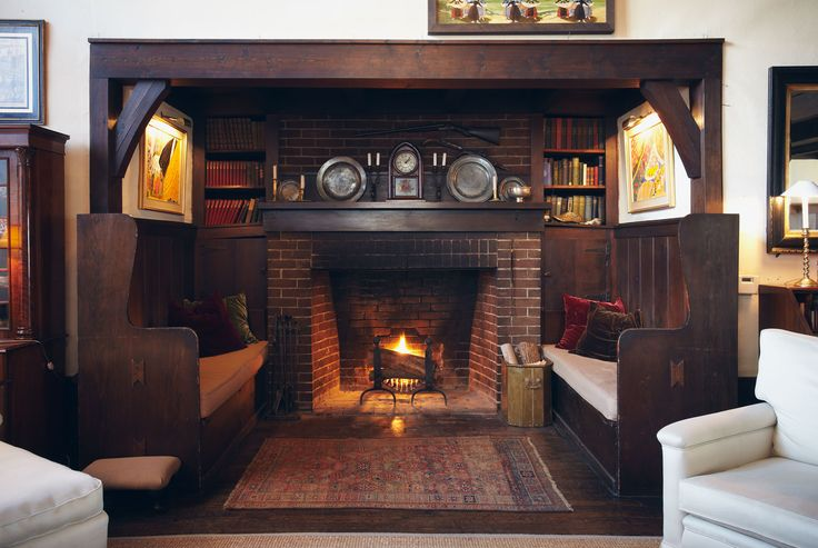 Cozy Benches On Either Side Of The Fireplace Fireplace