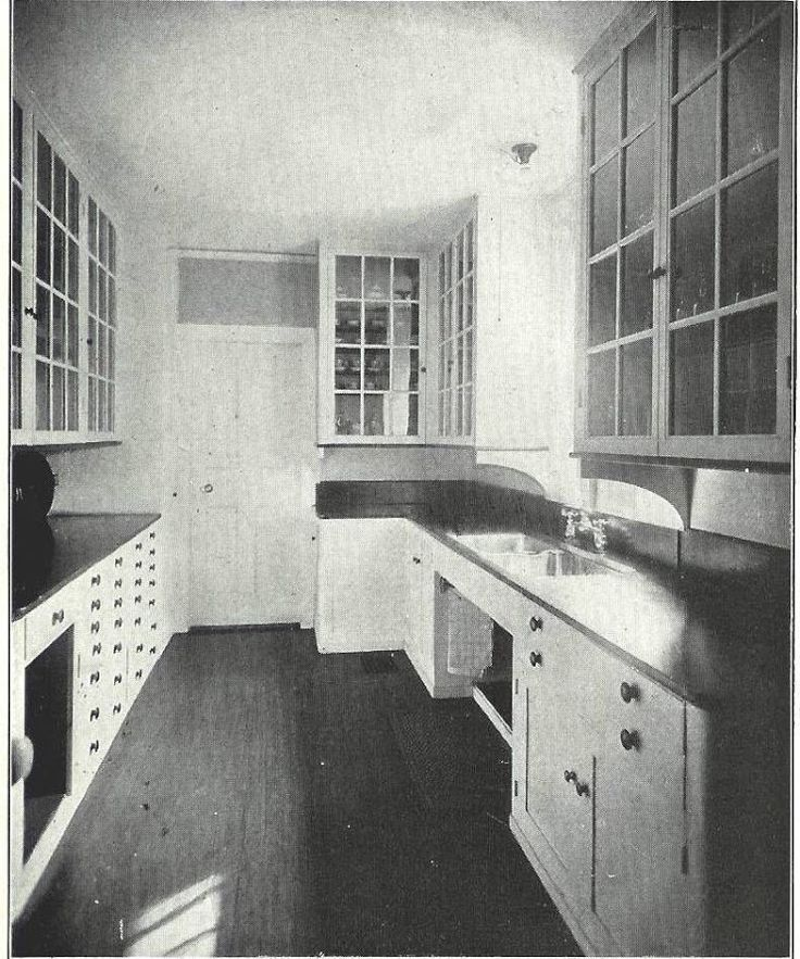Butler's pantry / original kitchen cabinets 1920s kitchen. similar to my galley kitchen layout. love the glass cabinets- soapstone countertops?