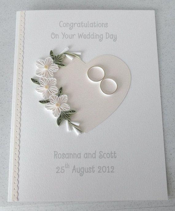 Tarjeta del día de boda enclavijada, Felicidades, personalizadas con los nombres de la novia y el novio y la fecha, quilled diseño, flores y corazón Un hermoso quilled tarjeta de boda con flores de quilling y enclavijada anillos de bodas, perfectos para enviar Felicitaciones muy