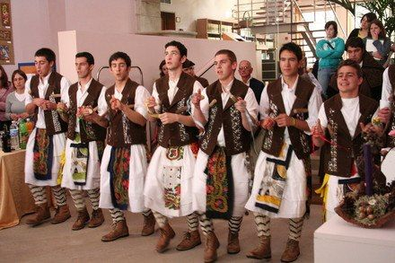 """These guys are wearing the Mirandese Kilt from Miranda do Douro, northern Portugal (Gallaécia). They're called """"Pauliteiros"""". Pauliteiros are practitioners of a war dance characteristic of the Lands of Miranda, called """"dança dos paus"""" (stick dance in english), representing local historical moments accompanied with the sounds of the bagpipes and drums."""
