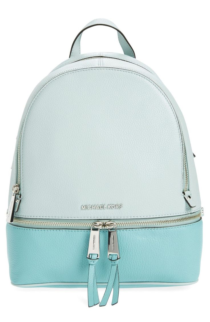 Carrying the essentials in this adorable, blue-hued color block backpack from Michael Kors.