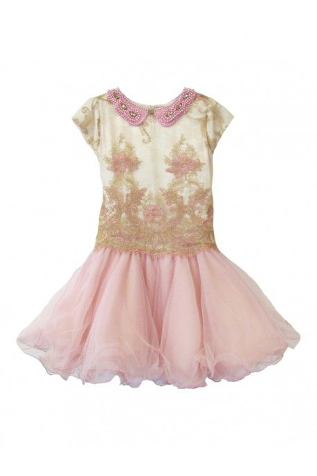 A stunning dress with body in bicolor lace completely embroidered in flower pattern