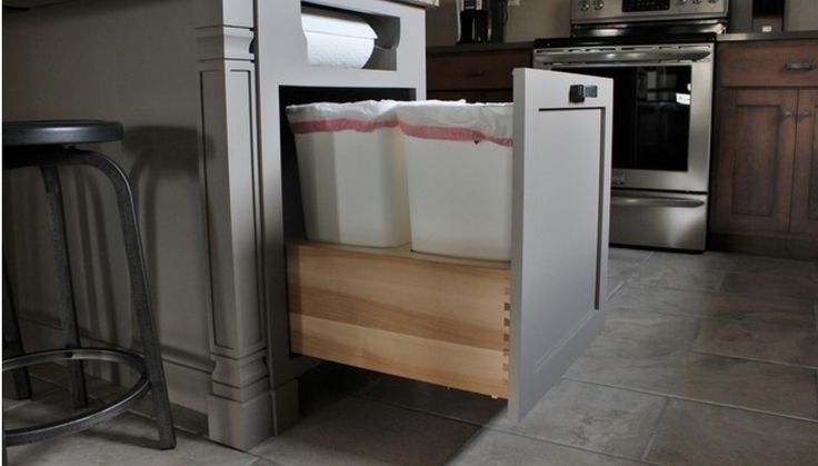This would be great in new island - built in paper towel rack and a recycling center