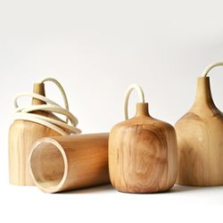 """""""Rolls"""", a series of handcrafted wooden lamps created by Chilean designer Isabel Lecaros."""