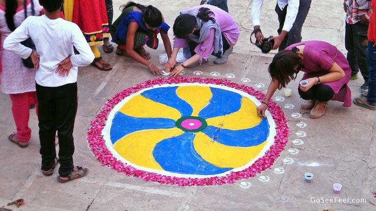 Making rangoli for Dev Deepawali at Banaras (Varanasi), India