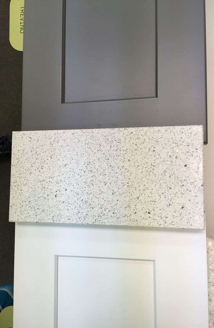 Echelon white and slate shaker cabinets & Ceasarstone Quartz Reflections #7141