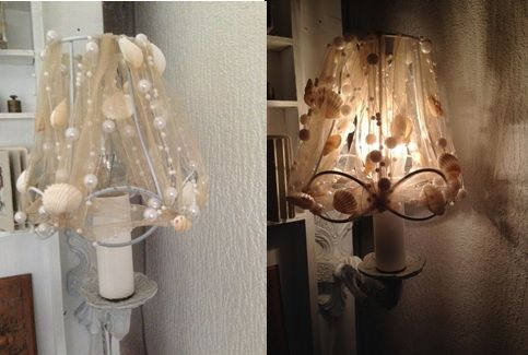 Unfortunately I forgot to take a 'before picture', but we are all familiar with these kind of lamps, maybe in our own or grand parents houses. I stripped the brown leather of the lampshade en spray painted the copper armature & lampshade frame. Surrounded the frame with some nice ribbon with shells and pearls, and... different kind of look.