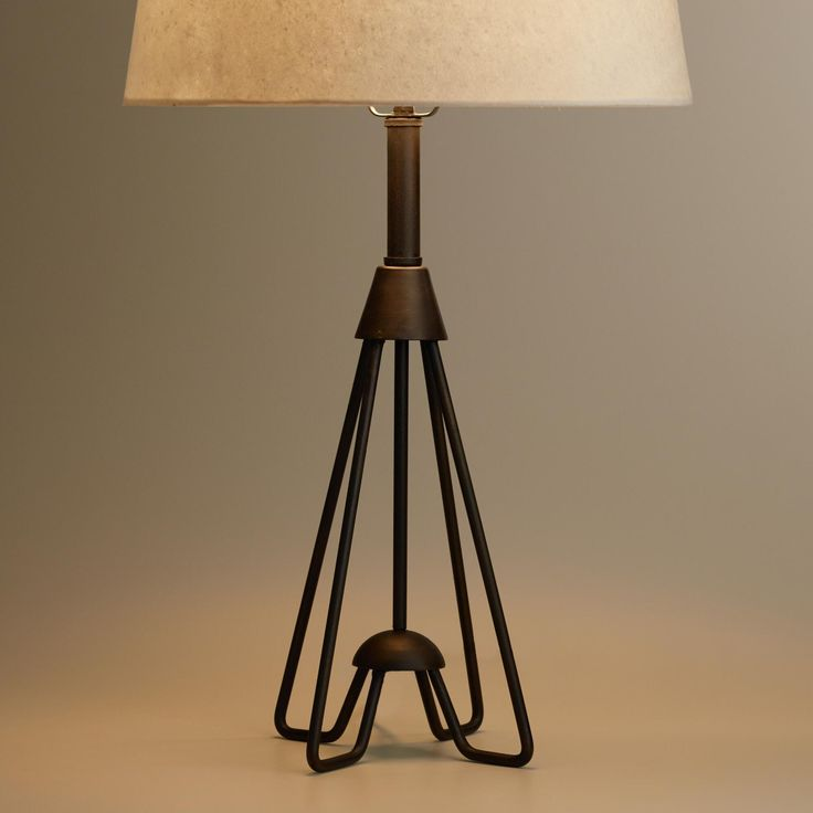 Crafted of iron with a black finish and an open design, our exclusive table lamp features mid-century-style hairpin legs for a vintage appeal. Create a coordinated look by pairing this architectural accent with our Hairpin Kent Floor Lamp Base.