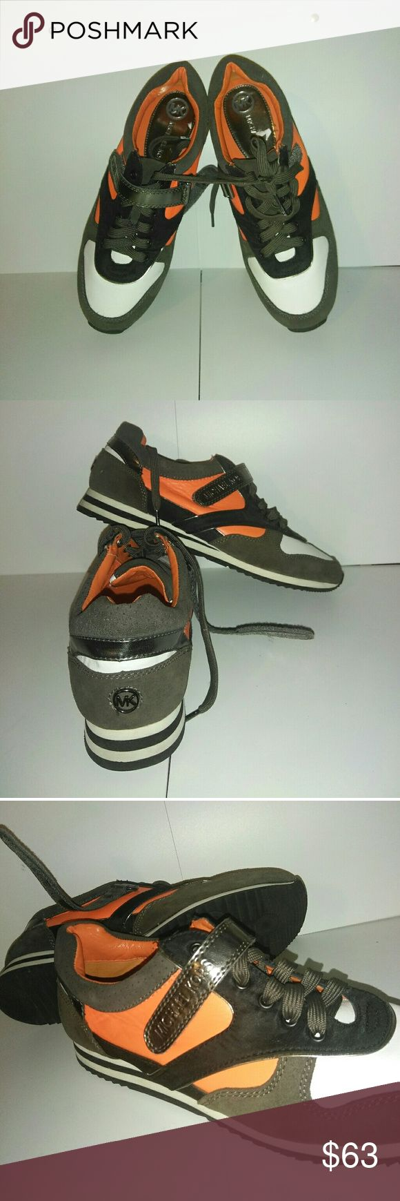 Micheal Kors women sneaker Pre-owned to new,  worn 1 time out of box. Do not have box. Authentic Michael Kors women sneaker. MK Allie trainer sneaker. Color,  orange,  black,  white,  grey. micheal kors Shoes Athletic Shoes