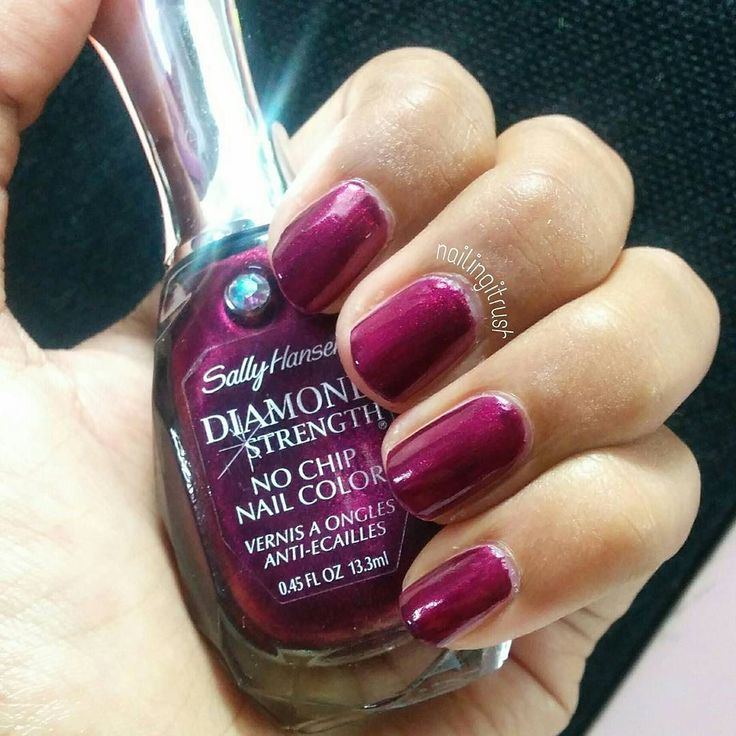"""Bling Bling!! Swatch of the @sally_hansen """"Save the Date"""" from the diamond strength collection! I really love this deep plum like color and unfortunately my camera does no justice to its beauty! (Trust me I clicked over 50 pictures). So they claim that this is a long wear no chip polish but I change my polish every two days or so and so I cannot vouch for that. First off I really adore the bottle   It does apply smoothly and shown here is 2 coats no top coat. Also it's absolutely AMAZING to…"""
