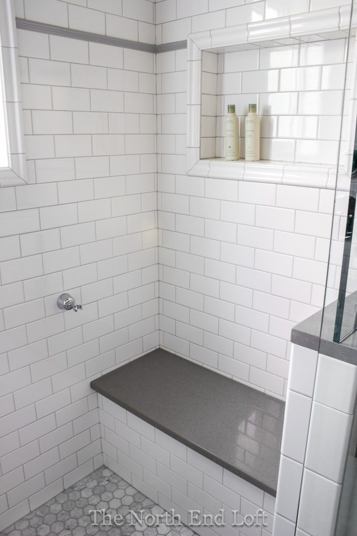 We chose shiny white subway tile with light gray grout for the walls, with an accent line of gray tile.