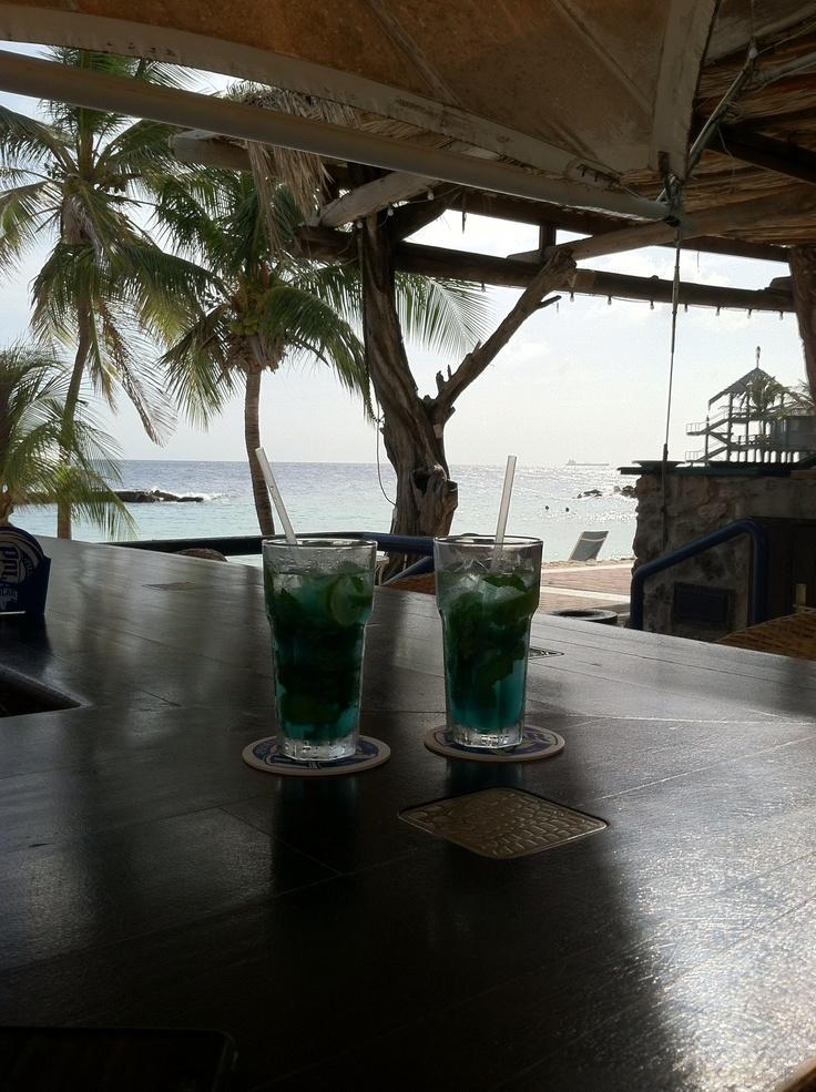Blue curacao mojitos. At the Avila beach hotel beach bar on curacao island