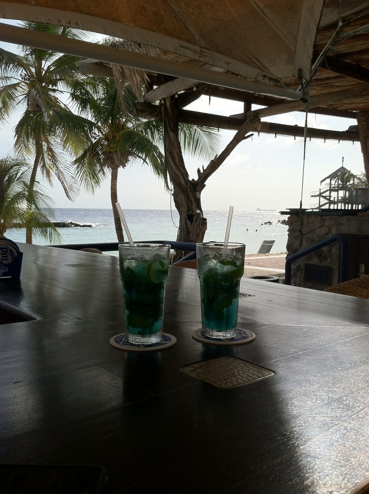 Blue curacao mojitos. At the Avila beach hotel beach bar on curacao island