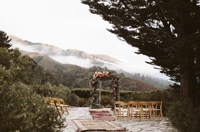 Cliffside Big Sur ceremony site with a floral arch