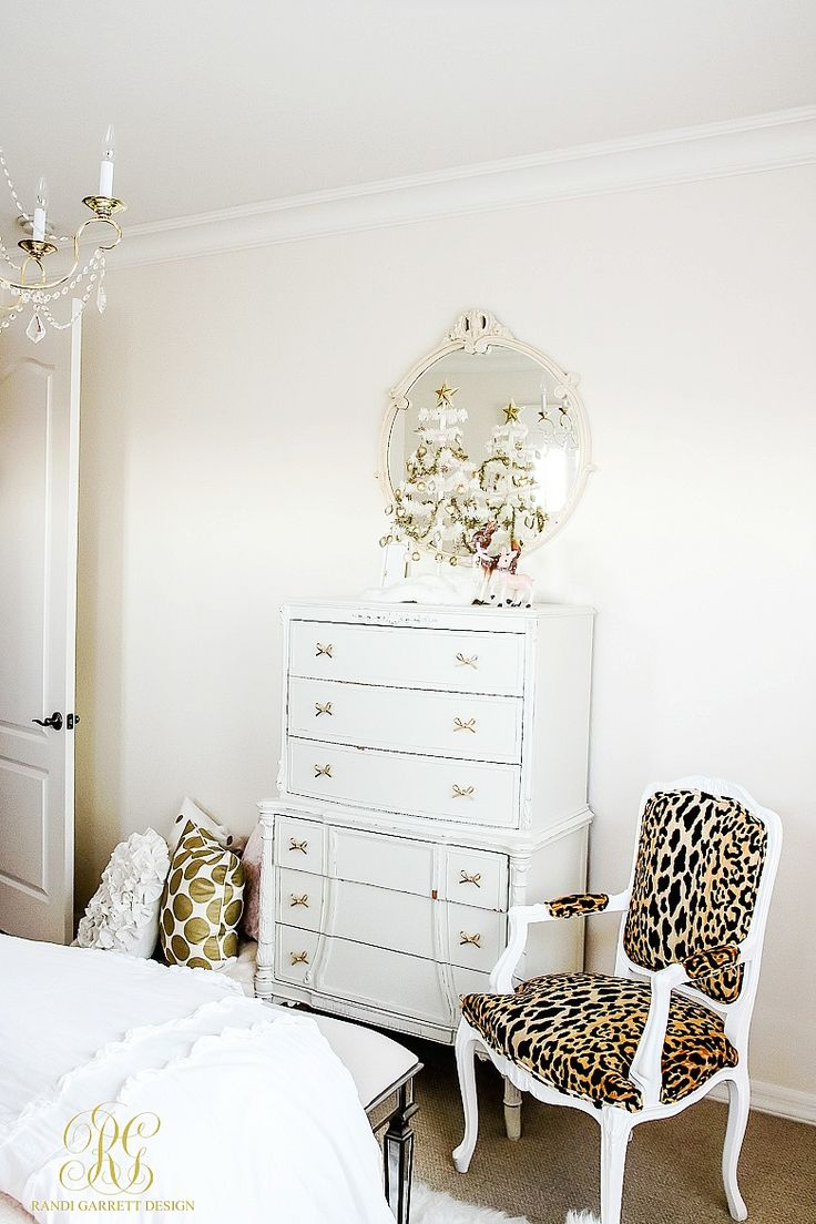 Christmas white feather tree, leopard chair, little girl room