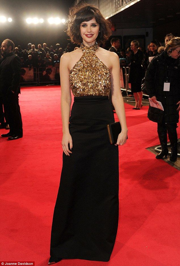 Alexander McQueen black and gold embellished dress~Felicity Jones  at the premiere of The Invisible Woman at the Odeon, Kensington High Street January 2014