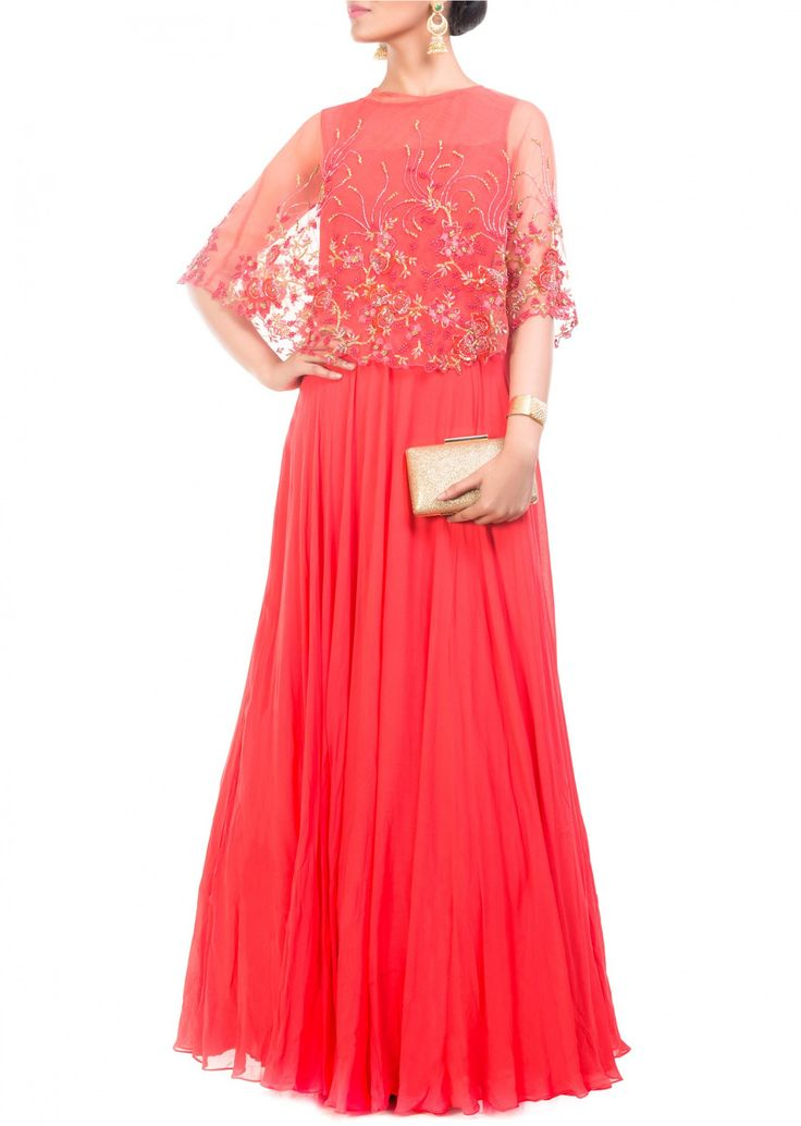 Featuring a floral embroidered, tomato red cape gown. The Cape has been intricately embroidered using sequins, beads and thread work.