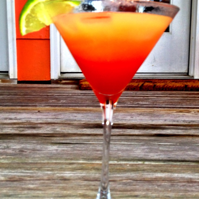 Yo Tai Mo Tai   2 tablespoons frozen orange juice 2 shots Spiced Rum 1 shot orange liqueur (Grand Marnier) 1 shot cocunut rum Pineapple juice Shake, add club soda, and gerenadine.