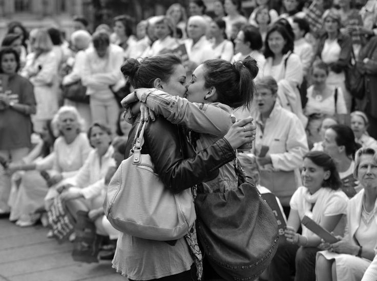 Lesbian couple kisses in front of a far-right Christian anti-gay protest in France. -I remember when you showed me this. You always are thinking of French things that I might like.