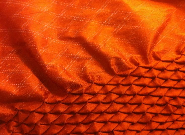 Smocking technique for creating dragon scale effect in silk.