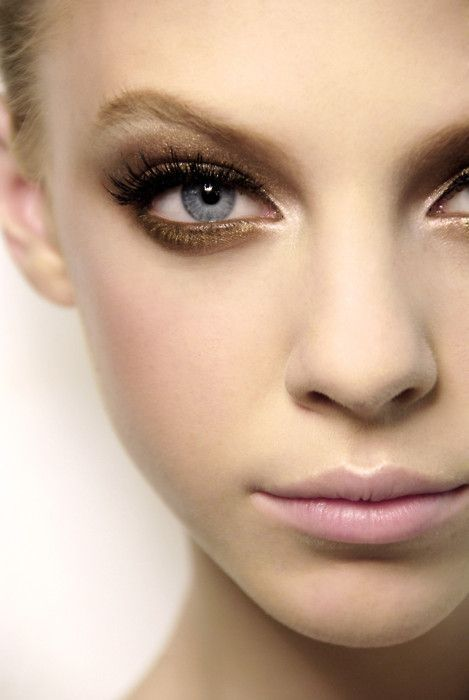 Gold eye make up and nude lips.