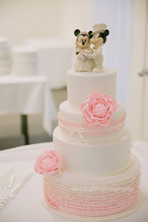 4 tier wedding cake, pale pink ruffles, ombre ruffles, sugar peony's gold tipped, mickey mouse, minnie mouse wedding, disney, ivory and pink wedding cakes. Wedding cakes with Sugar Flowers/decoration