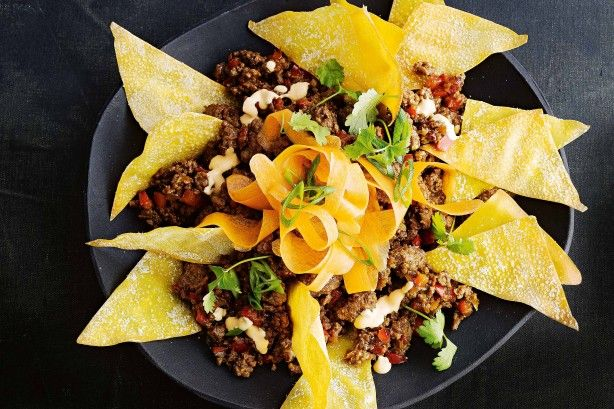 Crispy wonton chips make this Asian-style nachos a dinner or snack you'll come back for time and again.